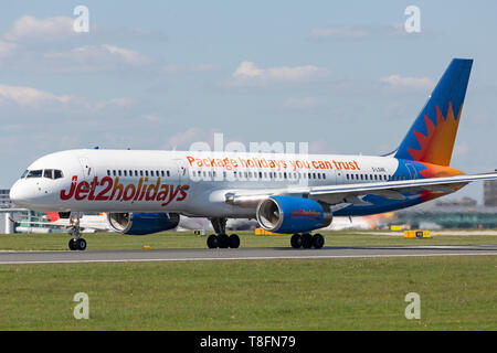 Jet2 Holidays Boeing 757-200, registration G-LSAE, taking off from Manchester Airport, England. - Stock Image