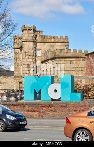 Museum of Lancashire logo with the courthouse in which it's hosted in the background. Portrait orientation. The museum has been closed since 2016. - Stock Image