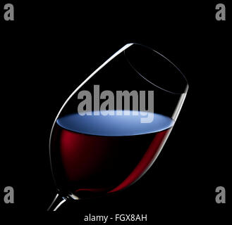 An angled glass of red wine - Stock Image