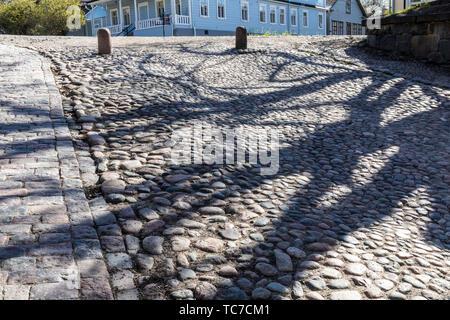 Shadows of trees on entrance ramp, Suomenlinna, Helsinki, Finland - Stock Image