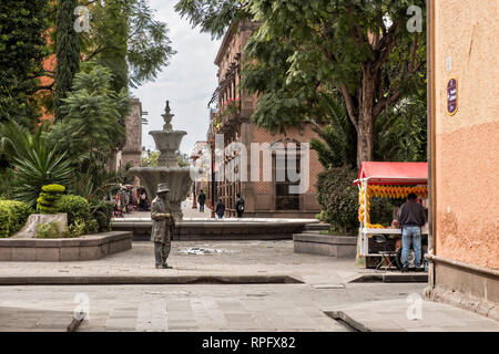 The statue of Juan del Jarro and fountain in the Guerrero Garden in the state capital of San Luis Potosi, Mexico. The sculpture by artist by Mario Cuevas, represents Juan del Jarro, who was a beggar, clairvoyant and popular philosopher. - Stock Image