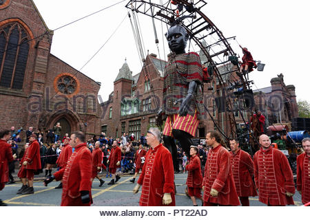 Liverpool, UK. 5 October 2018. The Little Boy Giant walks along Princes Road in Toxteth, Liverpool on Friday afternoon, 5th October. It is part of the Spectacular Giant street theatre event taking place in Liverpool over four days. The giant puppets are from the French company Royal de Luxe. Credit: Pak Hung Chan/Alamy Live News - Stock Image