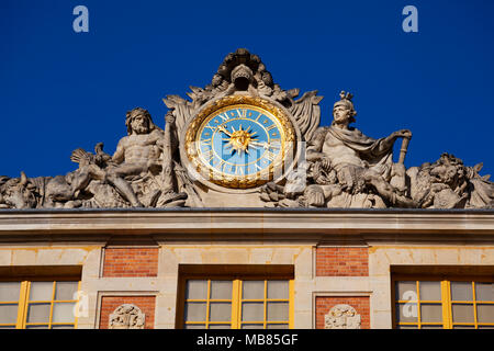 Chateau de Versailles (Palace of Versailles), a UNESCO World Heritage Site, France - detail of gilded clock above main entrance - Stock Image