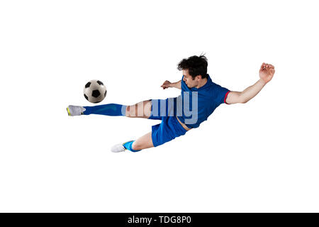 Football scene at night match with player kicking the ball with power. Isolated on white background - Stock Image