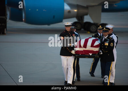 Members of the Joint Service Arrival Team carry the casket of Sen. John McCain at Joint Base Andrews, Md., Aug. 30, 2018. DoD personnel are honoring the former senator, and retired Navy Captain, by providing ceremonial support to his congressional funeral events. - Stock Image