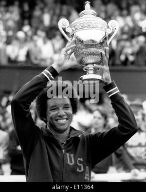 Jul 05, 1975; London, UK; A jubilant ARTHUR ASHE holds his trophy aloft when he became the new men's singles champion by knocking out his fellow countryman, Jimmy Connors (the holder) in the final at Wimbledon today. - Stock Image