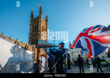 STEVE BRAY, founder of SODOM, carrying both a British and EU flag protests against Brexit outside Westminster London UK - Stock Image