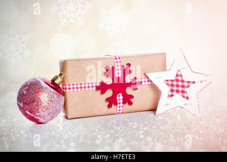 Christmas background with decorations and gift boxes on wooden board - Stock Image