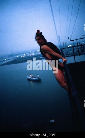 PICTURE CREDIT DOUG BLANE UK Naked BASE 1 BASE Jumping naked off Dartford Antenna London Great Britain - Stock Image