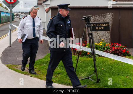 Macroom, West Cork, Ireland. 8th Oct, 2018. Superintendent Michael Fitzpatrick and Inspector Brian Murphy of Macroom Garda Station visit Dan Corkery Place, the location of the murder. The murder victim has been named locally as 44 year old Timmy Foley. Credit: Andy Gibson/Alamy Live News. - Stock Image