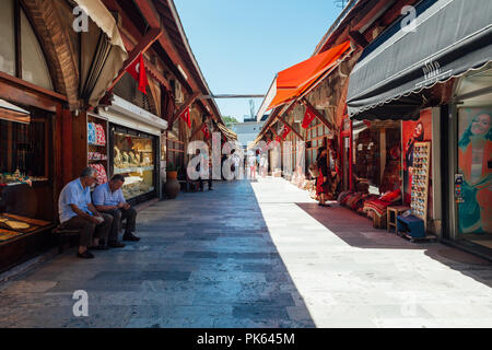 Istanbul, Turkey - August 14, 2018: People shopping at the Arasta Bazaar located near the Blue Mosque on August 14, 2018 in Istanbul, Turkey. - Stock Image