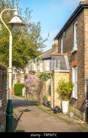 St Mary's Place – a small street of sunlit, brick built, pitched roof, period residential properties in Ealing, London W5, England, UK. - Stock Image