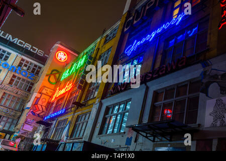 Old neon signs on a wall in Wrocław, Wroclaw, Wroklaw, Poland - Stock Image