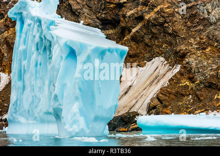 Greenland. East Greenland. Liverpool Land. Warming Island. Zodiac dwarfed by an iceberg. - Stock Image