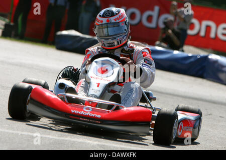 Spanish Formula One driver Fernando Alonso of McLaren Mercedes drives a cart near the race track 'Circuit de - Stock Image