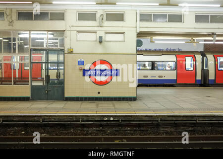 An underground train pulls into the East Finchley underground station in north London - Stock Image