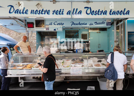 People shopping for seafood,, Siena Market, Siena, Tuscany Italy Europe - Stock Image