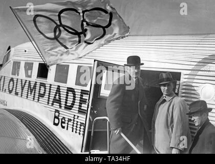 The general secretary of the Olympic Committee Carl Diem goes on a promotional tour for the Olympic Games in Berlin, 1936, aboard a Junkers Ju 52 / 3m of the Lufthansa. The aircraft with the registration D-ALYL had the special ornamental painting of the Olympic rings. - Stock Image