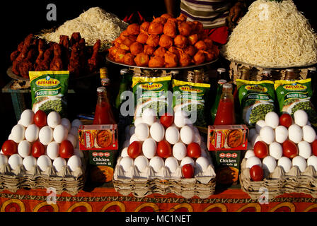 Street food Stall different spicy snacks and noodles with eggs and tomatoes masala powders for attracting customers business tactics Odisha India - Stock Image