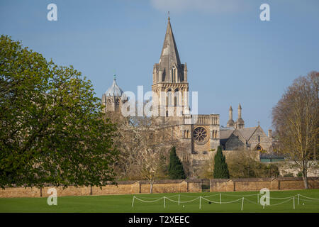 The spire and Rose window of Christ Church Cathedral, Oxford with Tom tower behind, early on a sunlit spring morning - Stock Image