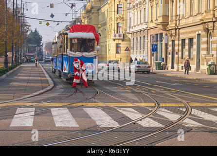 Santa operating tracks for Santa Claus tram, as part of the Advent Market celebration in Zagreb, going through the streets of the capital - Stock Image