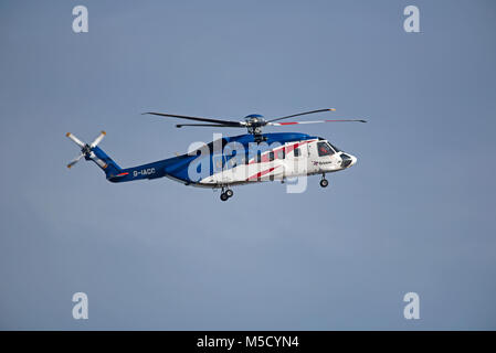 Bristows Sikorsky S-92 helicopter G-IACC returning to the Aberdeen Heliport from a North Sea Oil Platform. - Stock Image