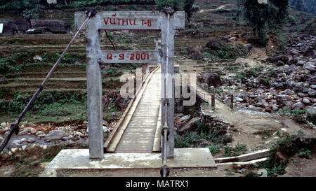 A new bridge opened on 12 September, 2001 makes transport easier between Sapa, Vietnam and surrounding indigenous communities. - Stock Image
