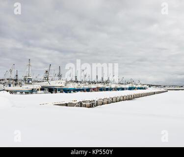 Fishing boats in the snow, Hokkaido, Japan - Stock Image