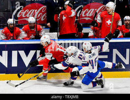 Bratislava, Slovakia. 15th May, 2019. L-R Nico Hischier (SWE) and Patrick Thoresen and Mathis Olimb (both NOR) in the match between Switzerland and Norway within the 2019 IIHF World Championship in Bratislava, Slovakia, on May 15, 2019. Credit: Vit Simanek/CTK Photo/Alamy Live News - Stock Image