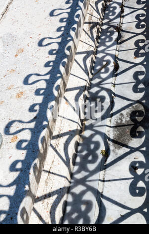 Cuba, Havana, Colon Cemetery. Wrought iron fence and shadow. Credit as: Wendy Kaveney / Jaynes Gallery / DanitaDelimont.com - Stock Image