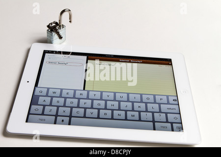 Ipad showing keyboard with a note saying Internet security and an unlocked padlock - Stock Image