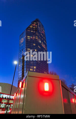 Red lights around construction site with modern skyscraper building in London, England - Stock Image