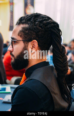 Rio de Janeiro, Brazil - March 21st, 2019: Close up of poker dealer with afro-hair at the the Main Event of the PartyPoker LIVE MILLIONS South America 2019 occuring at the luxurious Copacabana Palace Belmond Hotel in Rio de Janeiro, Brazil from March 15th through March 24th, 2019. Credit: Alexandre Rotenberg/Alamy Live News - Stock Image