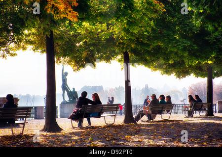 People Relaxing in a Park, Bürkliplatz, Zurich, Canton of Zurich, Switzerland - Stock Image