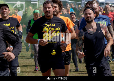 Mostly men running at the start of obstacle course run Splat Quack Go - Stock Image