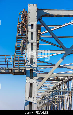 Group of the bridgewalking fans walk above the old Little Belt Bridge - Fredericia, Denmark. - Stock Image