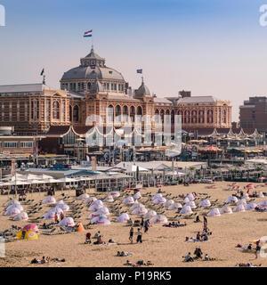 Scheveningen beach, and Holland Casino building, a popular coast resort close to The Hague (Den Haag), Netherlands. - Stock Image