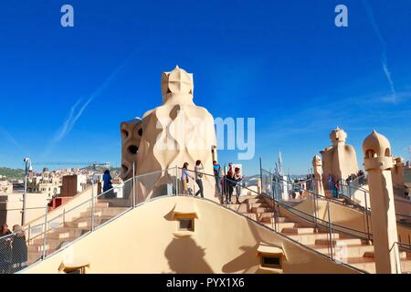 Barcelona, Spain, October 2018. On the roof of Antoni Gaudi's Casa Mila also known as La Pedrera. Bright sunny morning. - Stock Image