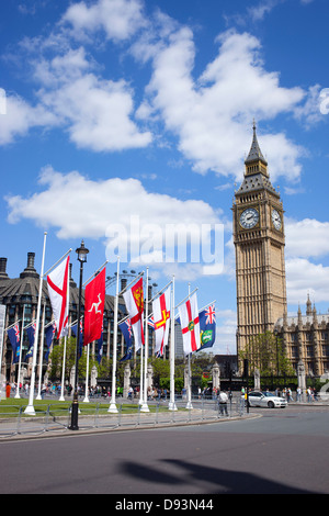 Flags of Her Majesty's Crown Dependencies and Overseas Territories, Parliament Square and Big Ben, London England. - Stock Image