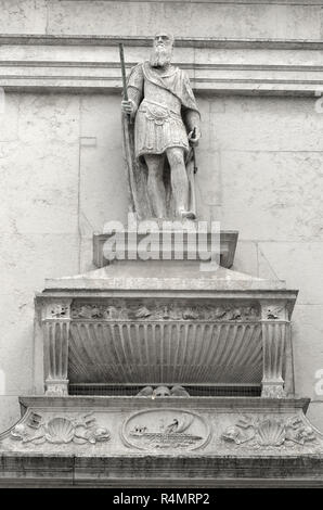 Old man dressed as roman standing on top of his remains in Venice Italy - Stock Image