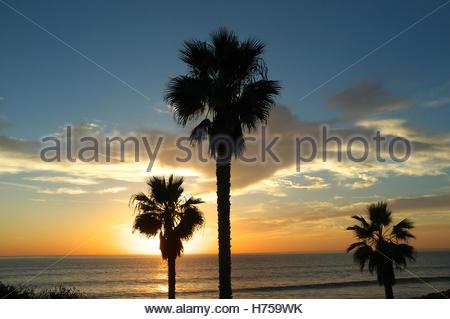 The sun sets across the Pacific Ocean, at Solana Beach (San Diego), California, USA. - Stock Image