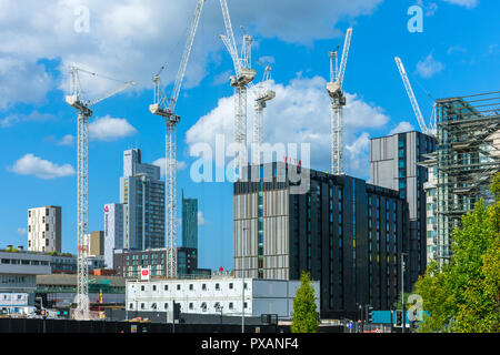 Tower cranes and the Vita Student apartment block at the Circle Square office and residential development, Oxford Road, Manchester, England, UK - Stock Image
