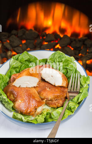 A serving dish of BBQ Chicken breasts with Little Gem lettuce. - Stock Image