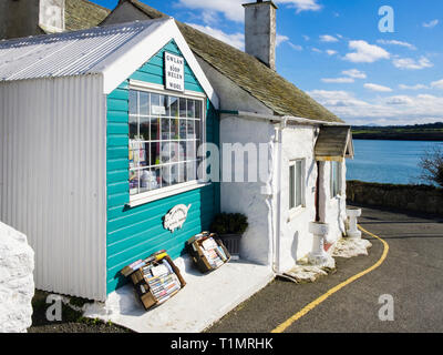 Wool shop and quaint tiny cottage in coastal village. Moelfre, Isle of Anglesey, Wales, UK, Britain - Stock Image