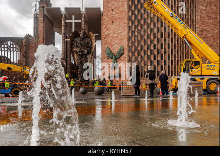 Coventry, West Midlands, UK. 14th March, 2019.  The Knife Angel, which is made up of 100,000 knives which were handed into police forces around the country, was erected outside Coventry Cathedral today. The Knife Angel is a 27 foot high sculpture composed of knives by the artist Alfie Bradley as a physical reminder of the effects of violence and aggression. It is in Coventry until 23rd April. Credit: Andy Gibson/Alamy Live News. - Stock Image