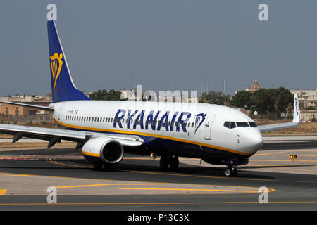 Boeing 737-800 commercial passenger jet belonging to the low cost airline Ryanair taxiing on arrival in Malta. Mass tourism and cheap air travel. - Stock Image