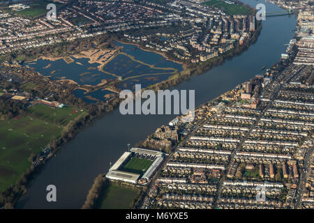 Aerial view of the Thames in West London looking west including Fulham football stadium and the London wetland centre - Stock Image