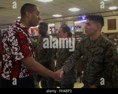 Franklin Parker, the assistant secretary of the Navy (manpower and reserved affairs), shakes Cpl. Draven Kleer, - Stock Image