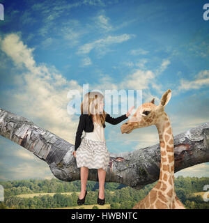 A little child is sitting on a tree branch petting a giraffe up in the sky for an imagination idea about animals - Stock Image