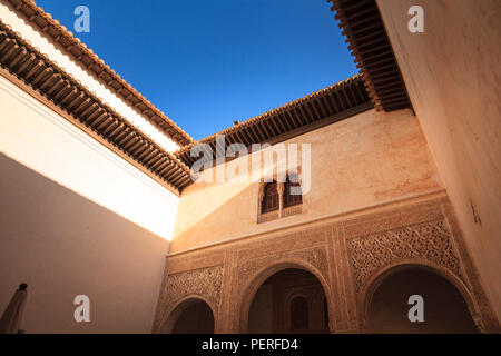 Decorative windows and plasterwork on the walls Alhambra Palace in Granada Spain - Stock Image